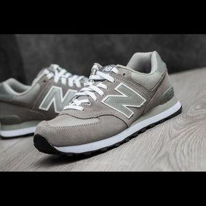 Gray and white new balance 574